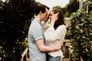 A couple looks at each other, smiling. They are feeling much happier after starting marriage counseling in Atlanta, GA with Faith and Family Empowerment.