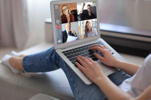 An individual uses a laptop for an online support group. She is happy with her decision to start an online anxiety support group in Atlanta, GA with Faith and Family Empowerment.