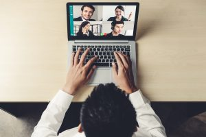 An individual is utilizing a laptop to speak to many people at the same time. He is happy with his decision to start online support group in Atlanta, GA with Faith and Family Empowerment.